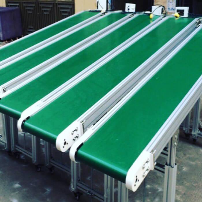 hệ thống băng tải pu màu xanh lá